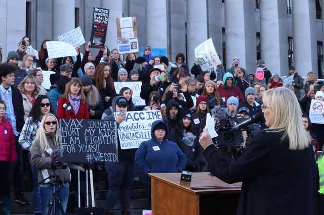 Anti-vaccine advocates rally outside the Washington State Capitol in Olympia.