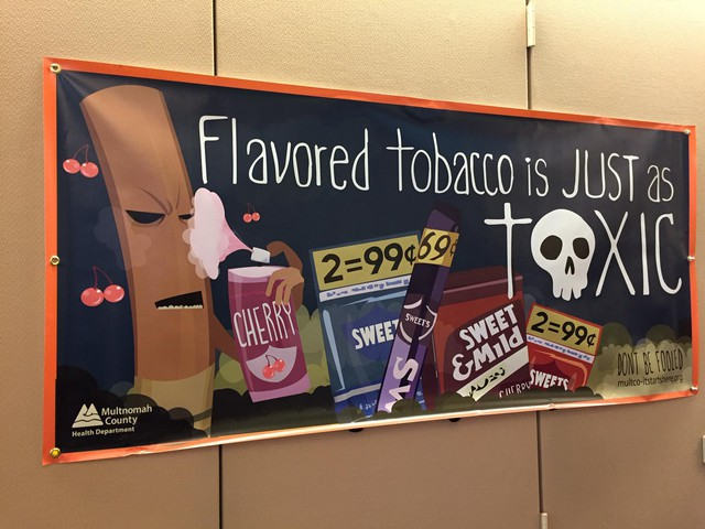 A sign at Multnomah County warns people about the dangers of flavored tobacco.