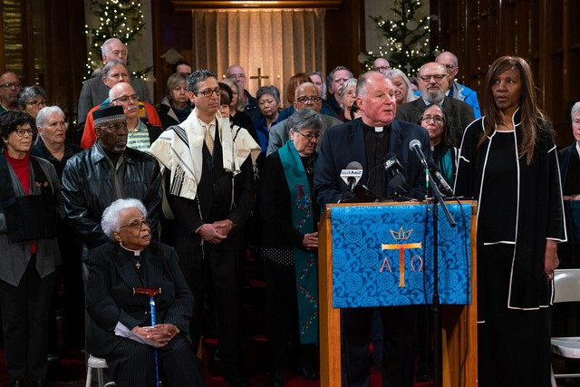 Rev. Dr. W.J. Mark Knutson, chair of Lift Every Voice Oregon, stands with about 40 faith leaders to announce an initiative petition to put new gun laws on the 2020 ballot on December 9th, 2019 in Portland, Oregon
