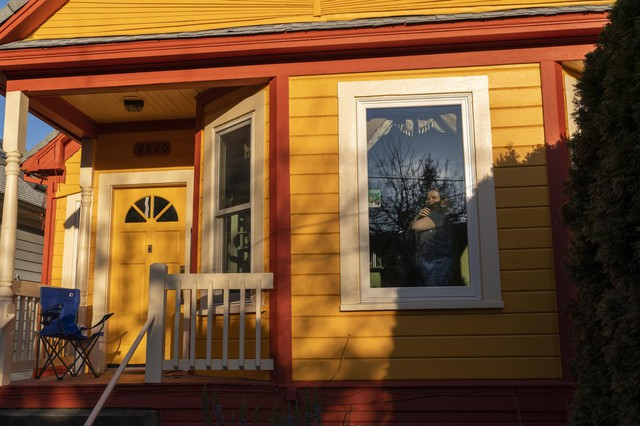 Portlanders pose for window portraits to maintain a proper social distance.