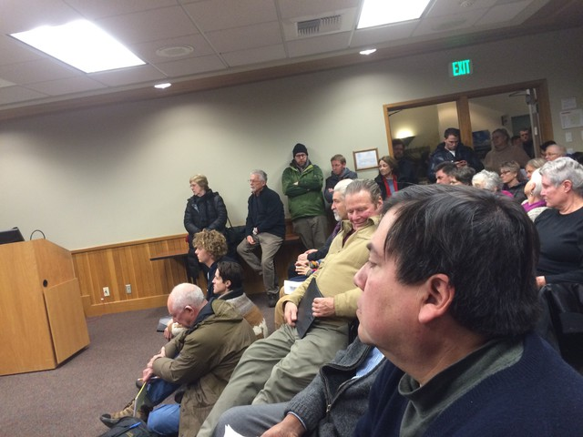 """Greg Delgado listens as the """"Not In Our Town"""" proclamation is read at a December meeting of the Bend City Council."""