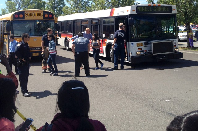 Reynolds High School students exit TriMet bus after being transported from the school to the Wood Village Fred Meyer to meet up with their parents.