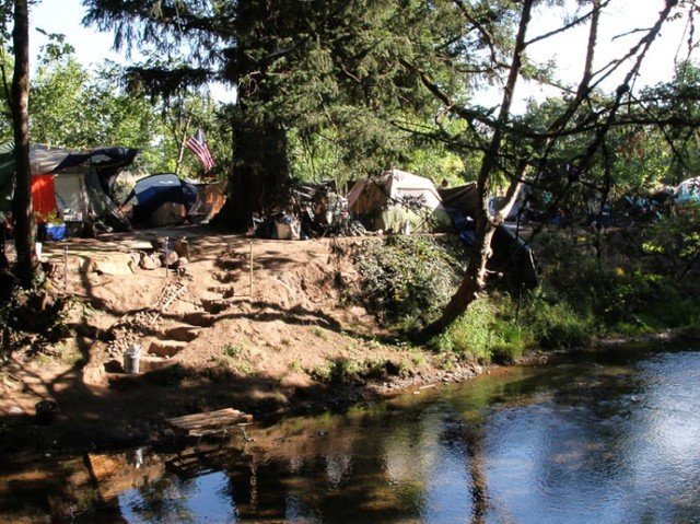 Homeless campers have carved stairs down to Johnson Creek and use the creek to wash clothes and mattresses.