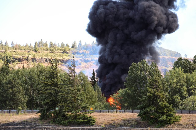 An oil train fire rages on near the bank of the Columbia River on Friday, June 3, 2016.
