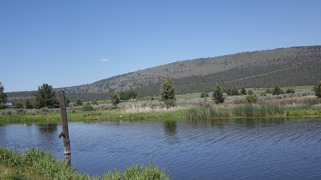 An agricultural valley near Klamath Falls. The drastic elevation change exemplified in the distance is necessary for pumped storage hydroelectricity projects.