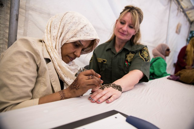 Zahra Hadid draws a henna tattoo on Amy Johnson's hand at the Portland International Muslim Cultural Festival, Saturday, July 8, 2017.