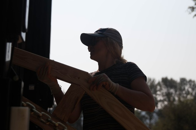 PSU students load all 690 trusses onto a semi-truck.