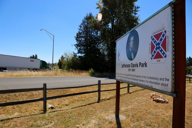The Jefferson Davis Park sits alongside the heavily-trafficked Interstate-5 freeway. The Confederate monument was recently struck by protesters.