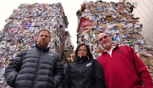 Rogue Waste System's Scott Fowler (left) and Laura Leebrick (center) have nowhere to send about 2,000 tons of baled and stacked of co-mingled recycling.