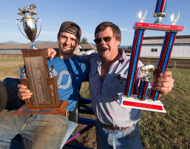 Ben Salo and his father Ken celebrate Ben's first-place win at the 2014 Tillamook County Fair Pig-N-Ford World Championships.