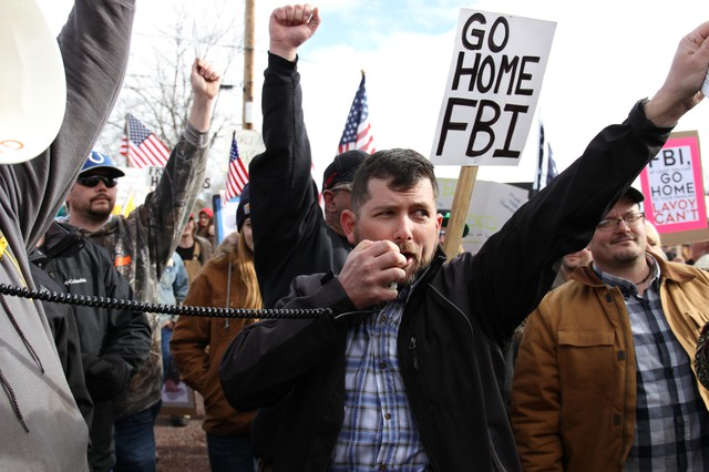 B.J. Soper speaks into a megaphone. Protesters with the Pacific Patriots Networkfaced a counter protest of Harney Countyresidents during the occupationin Burns in January 2016.