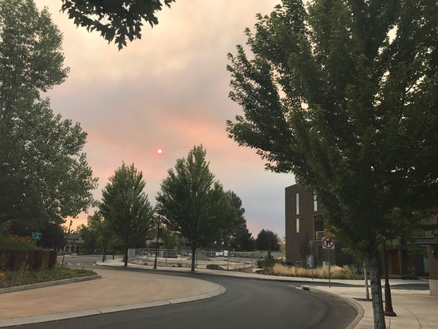 Smoke from the Milli fire threatening Sisters, as seen from Bend.