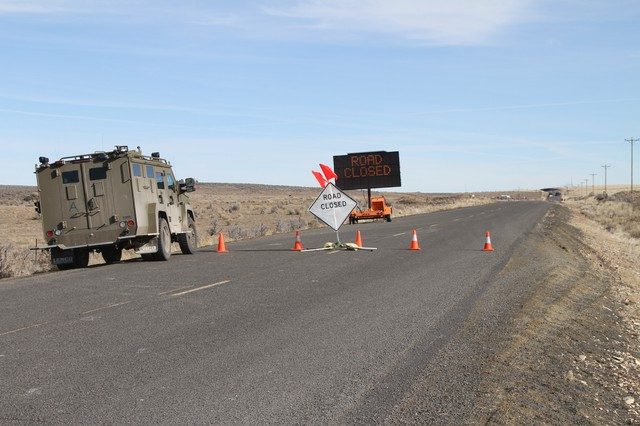 A camouflage truck crosses the road block into the Malheur National Wildlife Refuge Sunday, Feb. 7, 2016.