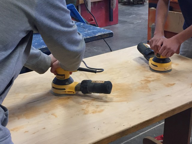 Students use power sanders in the Sunridge Middle School wood shop, in Pendleton.