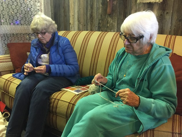 Helen Hardwick, left and Helen Patton talk about the refuge occupation during knitting group in Burns.