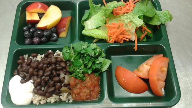 A recent school lunch at Abernethy Elementary School in Portland: rice and beans, house-made salsa, cilantro, sour cream, fruit and salad.