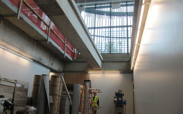 Floor cuts above let natural light into the lower level of the building, which reduces electric lighting needs for the lower offices.