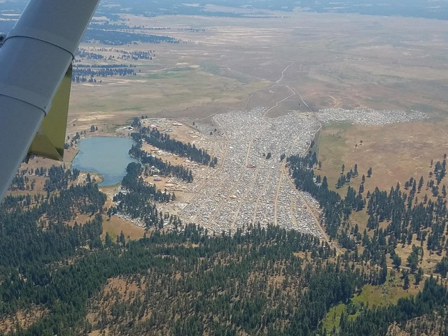 An aerial photo of the Symbiosis Festival on private land in the middle of the Ochoco National Forest.