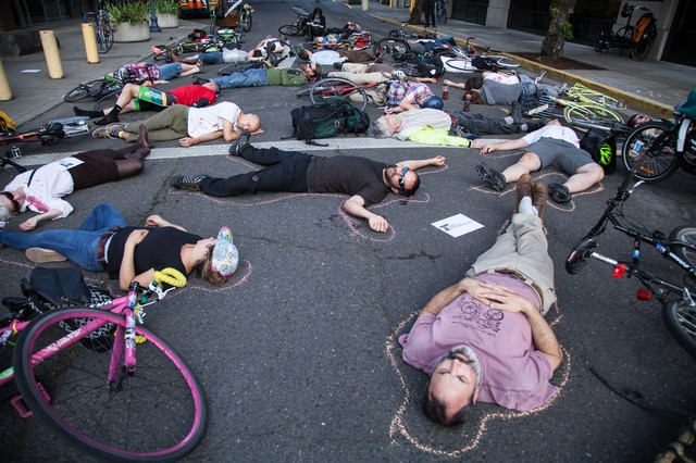 Over 30 bicycle riders and advocates gathered outside of Oregon Department of Transportation offices in Portland, Oregon in May. The riders gathered to protest unsafe road conditions after a cyclist recently lost a limb in an accident.