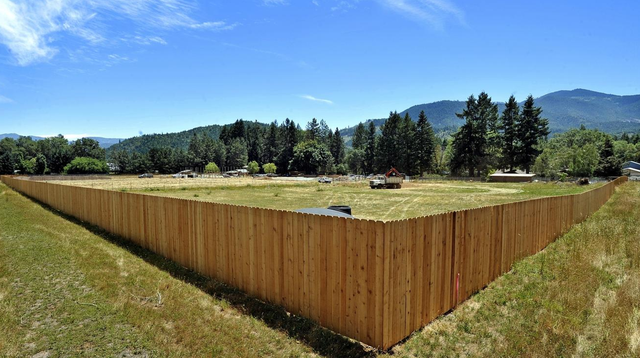 Another large-scale marijuana facility is under construction on Williams Highway, protected by the long opaque fences that irritate many neighbors.