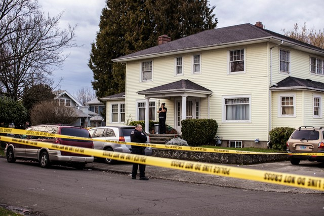 Police tape circles a crime scene in NE Portland.