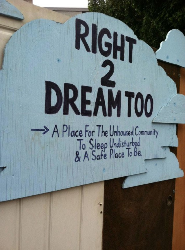 A sign welcomes visitors to the Right 2 Dream, Too homeless camp in Portland, Oregon.