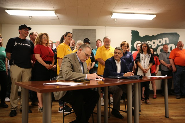 President of the Oregon AFL-CIO Tom Chamberlain and Presidentof the Portland Diamond Project Craig Cheek signed an agreement Monday that states the future baseball stadium's entireworkforce will be allowed to join a union.