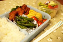 Re-creation of my mother's typical bento which includes rice, deep-fried chicken, egg omelets, green beans and more