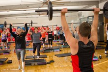 Students get a full body workout in a Body Pump Class taught by OSU exercise science student Jacob Taskinen.