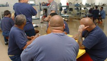 Prison inmates play cards and board games in a room at Oregon State Penitentiary. (file photo)