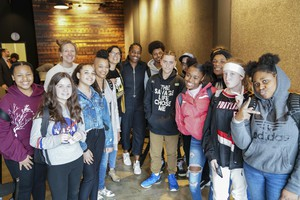 Author Jacqueline Woodson (center) poses with students from Ockley Green Middle School at Literary Arts in downtown Portland.