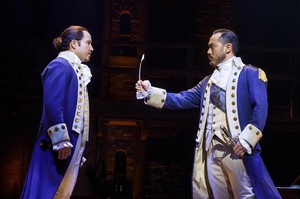 "Joseph Morales as Alexander Hamilton and Marcus Choi as George Washington in the second national tour of ""Hamilton""."
