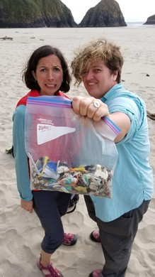 OPB reporters Cassandra Profita and Jes Burns with plastic found on an Oregon beach.  Some plastic that ends up here likely entered the ocean via river.