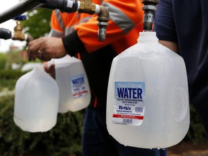 Salem Public Works employees fill gallon jugs with water at a water distribution site in Bush's Pasture Park in Salem, Oregon, on Friday, June 8, 2018.