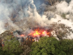 This Wednesday, May 16, 2018, image provided by the U.S. Geological Survey shows lava spattering from an area between active Fissures 16 and 20 photographed at 8:20 a.m. HST, on the lower east rift of the Kilauea volcano, near Pahoa, Hawaii.