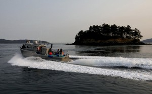 The Lummi police boat heads to the west side of San Juan Island in an attempt to feet chinook salmon to an ailing young orca, J50, seen from the King County Research Vessel SoundGardian, Friday, Aug. 10, 2018.