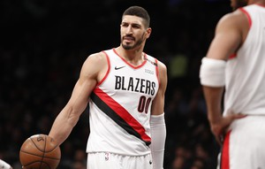 Portland Trail Blazers center Enes Kanter (00) questions a call during the first half of an NBA basketball game against the Brooklyn Nets, Thursday, Feb. 21, 2019, in New York.