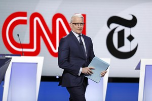 Anderson Cooper, CNN anchor, walks onstage for a Democratic presidential primary debate hosted by CNN/New York Times at Otterbein University, Tuesday, Oct. 15, 2019, in Westerville, Ohio.