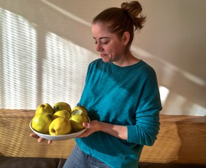 Portland chef Katy Millard, holding a dish of seasonal quince, finds the heart of Thanksgiving where tradition and its opposite collide. She poaches quince in simple syrup with star anise as a side or uses the poached quince in place of apples or pears in fall salads.