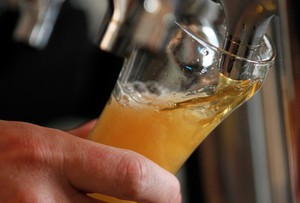 In this Aug. 20, 2012, file photo a brewer pours a sample of beer. America loves its beer and its fine dining, so why is it so hard to find the perfect pairing of thetwo?