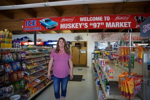 Carey Hughes is the owner of Huskey's 97 Market, the lone grocery store in the town of Moro, Oregon. She says most of her regulars are ranchers and farmers, who have been busy fighting the Substation Fire.