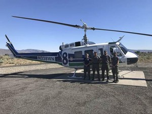 The helicopter crew that rescued the unidentified researcher. CREDIT: WASHINGTON DEPARTMENT OF NATURAL RESOURCES