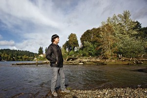 Travis Williams, head of the Willamette Riverkeeper, stands where Johnson Creek flows into the Willamette River in Milwaukie. Williams says PCBs in the creek could migrate to the river and then the Portland Harbor Superfund site.