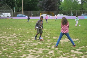 "Fourth graders at Grout Elementary in Southeast Portland do soccer drills as part of a program called ""Playworks."" It was partially funded by a grant from the Portland schools foundation, All Hands Raised."