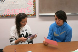 Jennifer Rodriguez (left) and Edith Velasco take an oral Spanish exam at Riverside High School in Boardman. Passing the test gives them 12 college credits.