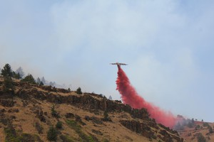An air tanker drops retardant over the Corner Creek fire in Central Oregon, July 11, 2015.
