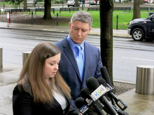 Mike Arnold, right, and Lissa Casey give a press conference in Portland in January.