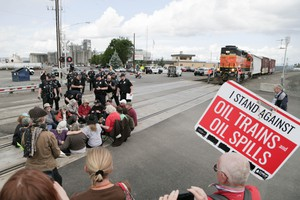 Police move on a group of protesters blocking the tracks at the BNSF Railway station in Vancouver, Washington, on Saturday, June 18, 2016.