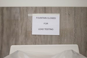 A sign hangs over a closed-off drinking fountain at Lleweyn Elementary School in Southeast Portland. Portland Public Schools shut off drinking water May 27. The district is distributing free bottled water to students.