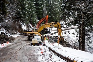 Crews clean up a stretch of Highway 22 damaged by a tanker crash, gas spill and fire.